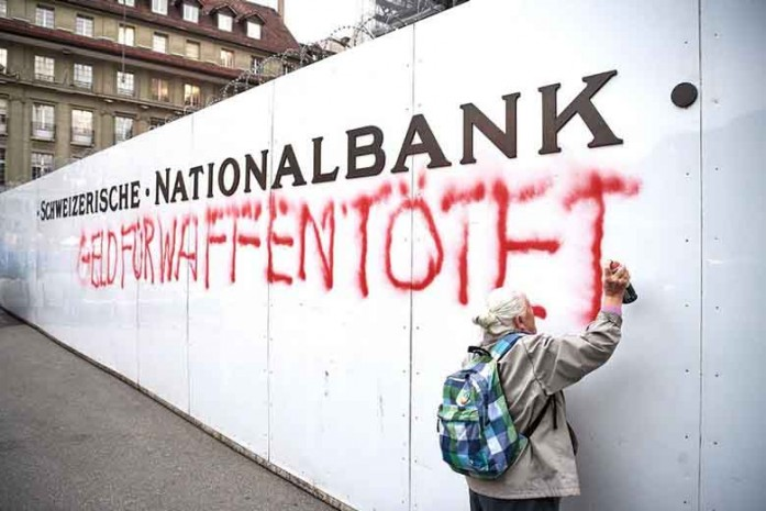 86 YEAR OLD WOMAN SPRAYPAINTS ON SWISS NATIONAL BANK